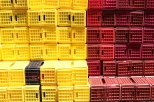 Yellow and red crates are stacked at the Boekenhoutskloof winery in Franschhoek, South Africa.